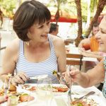 Women Over 50 Enjoying a Meal Together