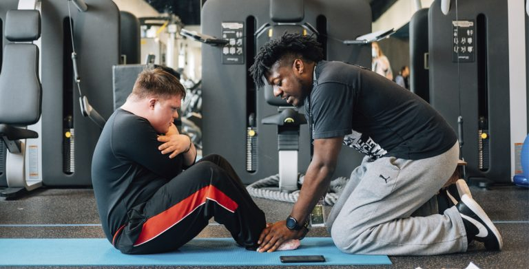 Exercising with a personal trainer at My Possibilities in Texas