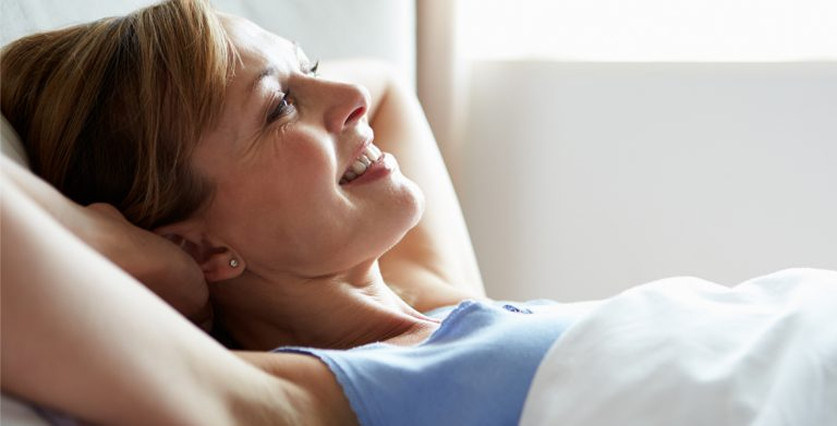 A Woman in Bed Setting Intentions for the Day